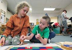 boy and girls working together in classroom - Oak Meadow School, Littleton, MA