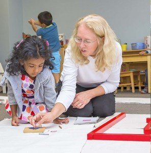 Blond teacher working with young girl