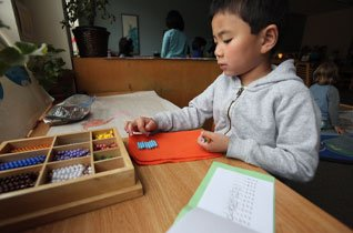 Young boy working on puzzle