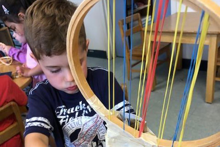 boy working on project - Oak Meadow School, Littleton, MA